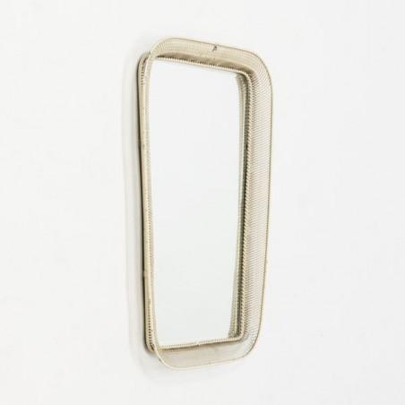 Perforated metal mirror
