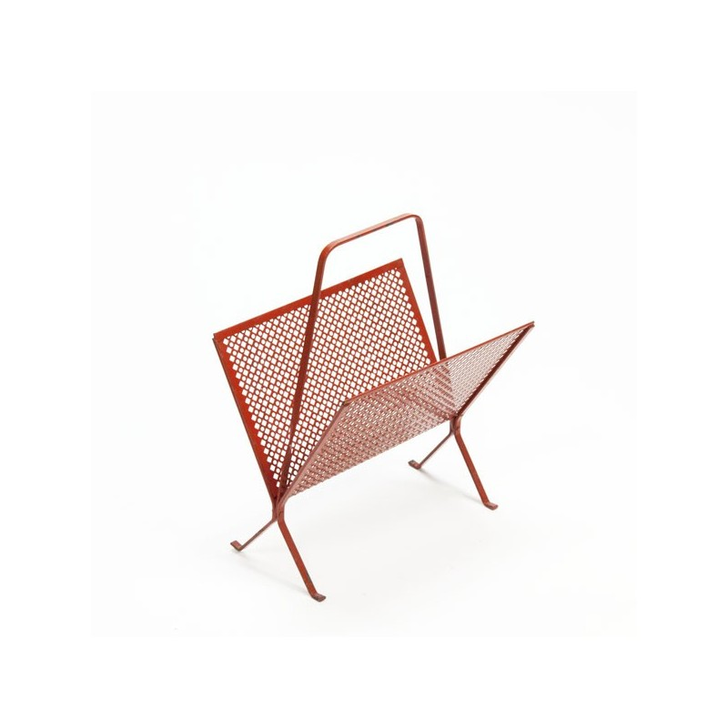 Red perforated metal magazine rack