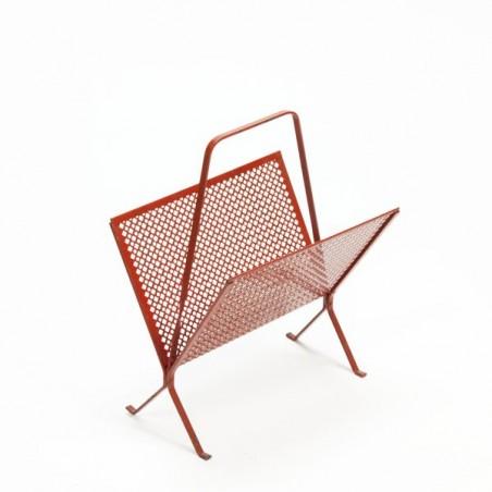 Red perforated metal magazine rack