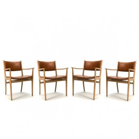 Set of 4 chairs with cognac leather upholstery