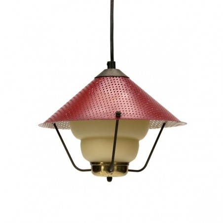 Hanging light with red perforated shade