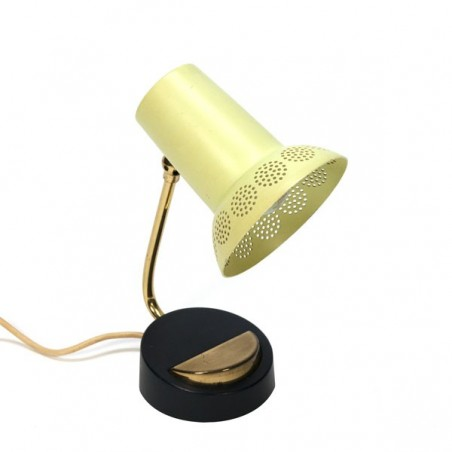 Small table lamp with perforated yellow cap