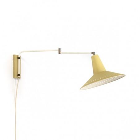 Wall lamp with yellow shade