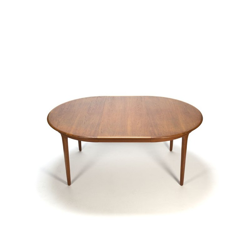 Extendable round teak dining table