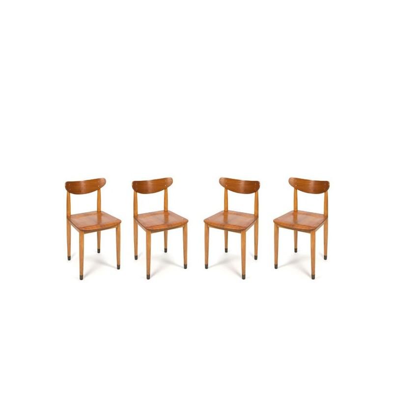 Set van 4 houten stoelen op koperen voetjes