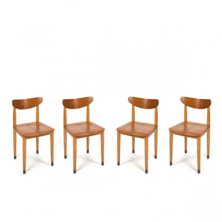 Set of 4 wooden chairs on brass feet