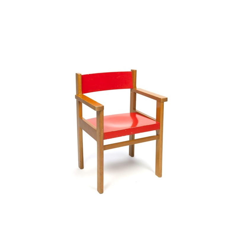 Wooden children's chair with red seat