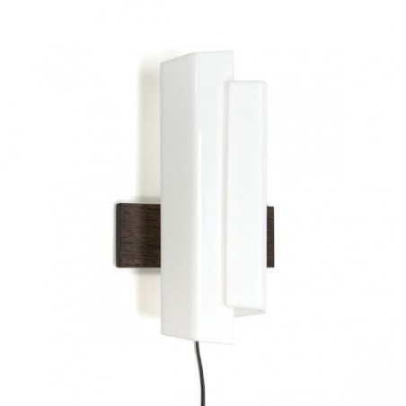 White plexiglass wall lamp with wooden back