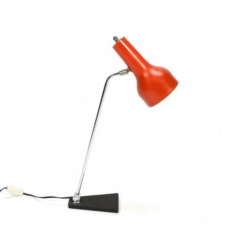 Desk lamp with orange shade and black base
