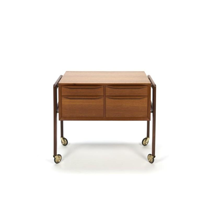 Danish teak cabinet on brass wheels