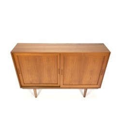 Small teak cabinet with sliding doors