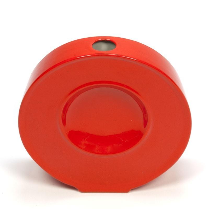 Round orange ceramic vase