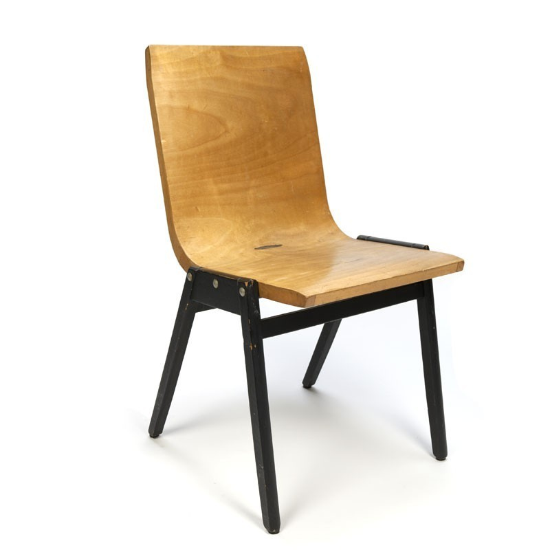 Stacking chair by designer Roland Rainer