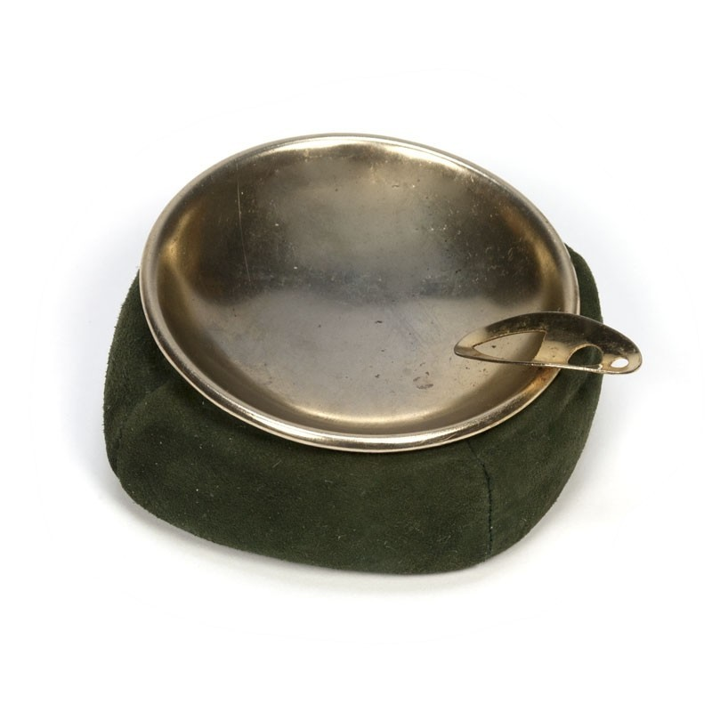 Vintage brass ashtray with green leather