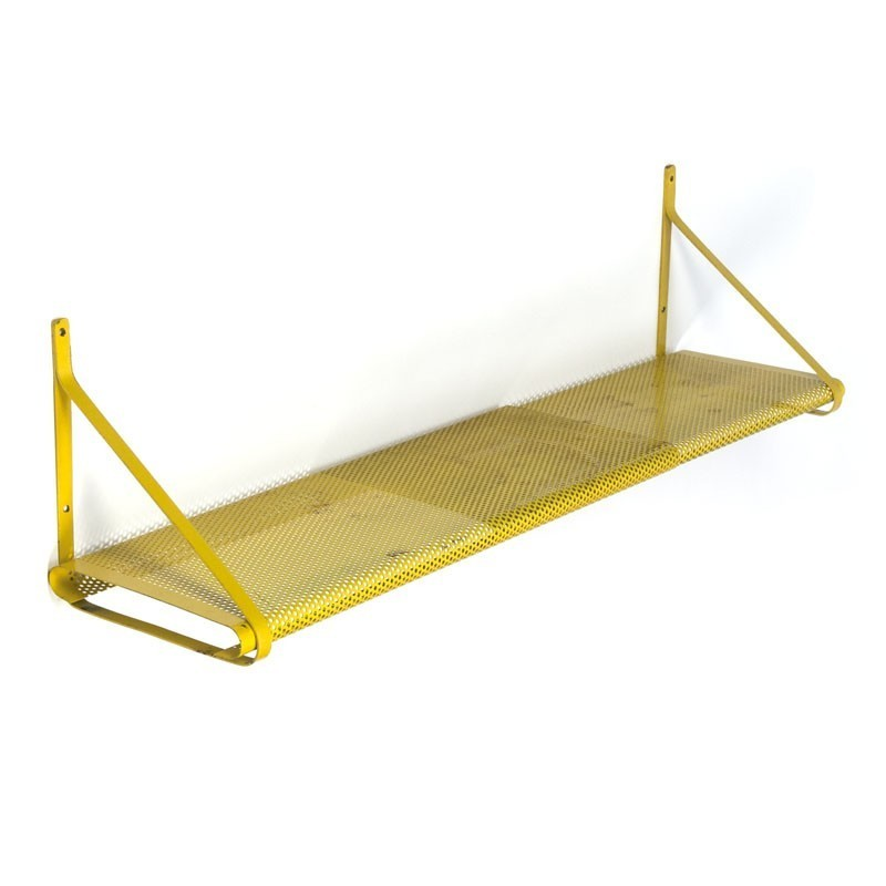 Vintage perforated metal shelf in yellow