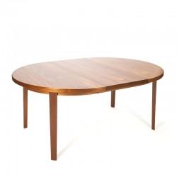 Round teak extendable vintage Danish dining table
