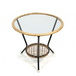 Vintage round wicker table with glass top