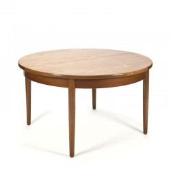 Round vintage dining table in teak with extendable leaf