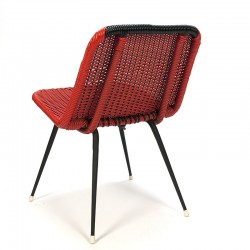 Red vintage chair made of braided plastic wire