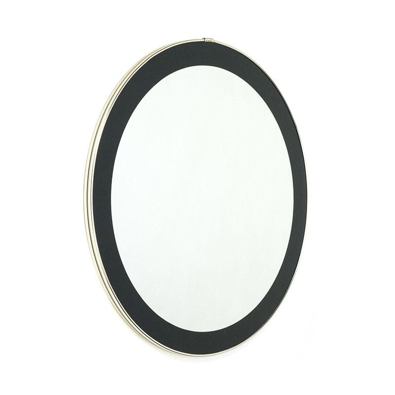 Round vintage mirror with brass colored rim