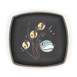 Vintage ceramic plate with fish