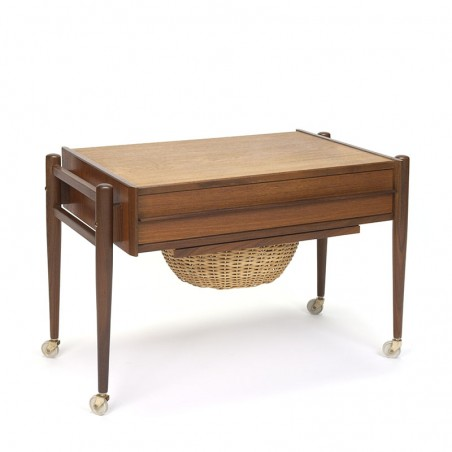 Vintage teak side table on wheels with wicker basket