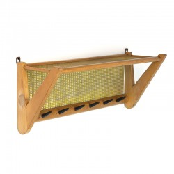 Vintage coat rack with perforated metal hat shelf