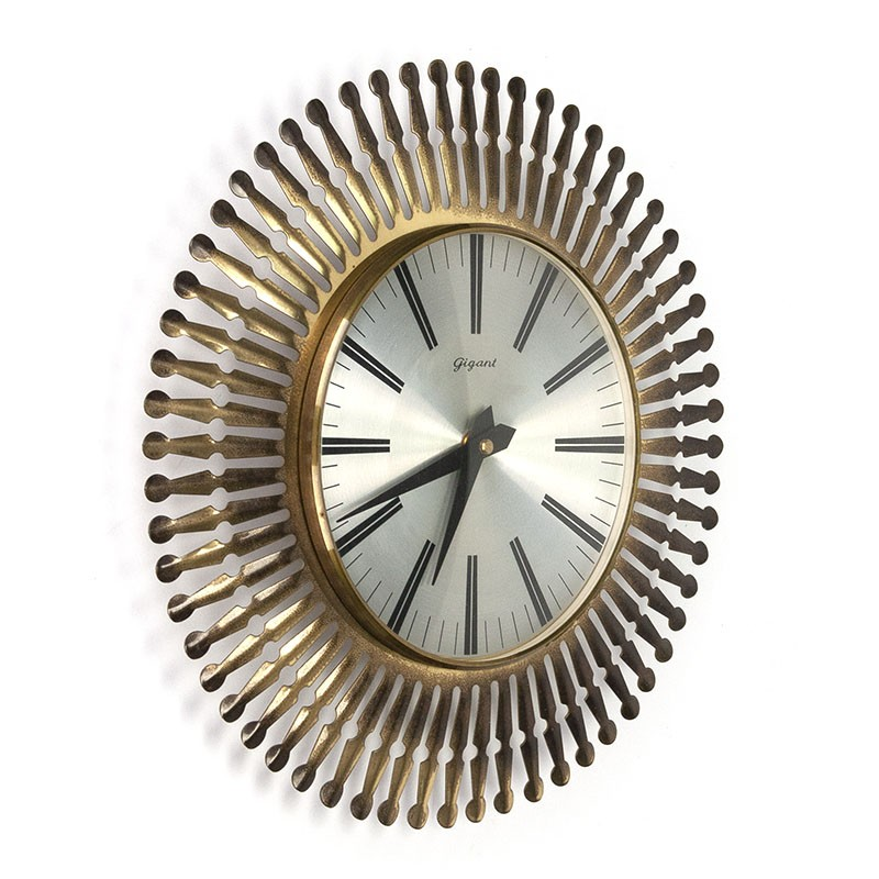 Vintage brass clock sun model