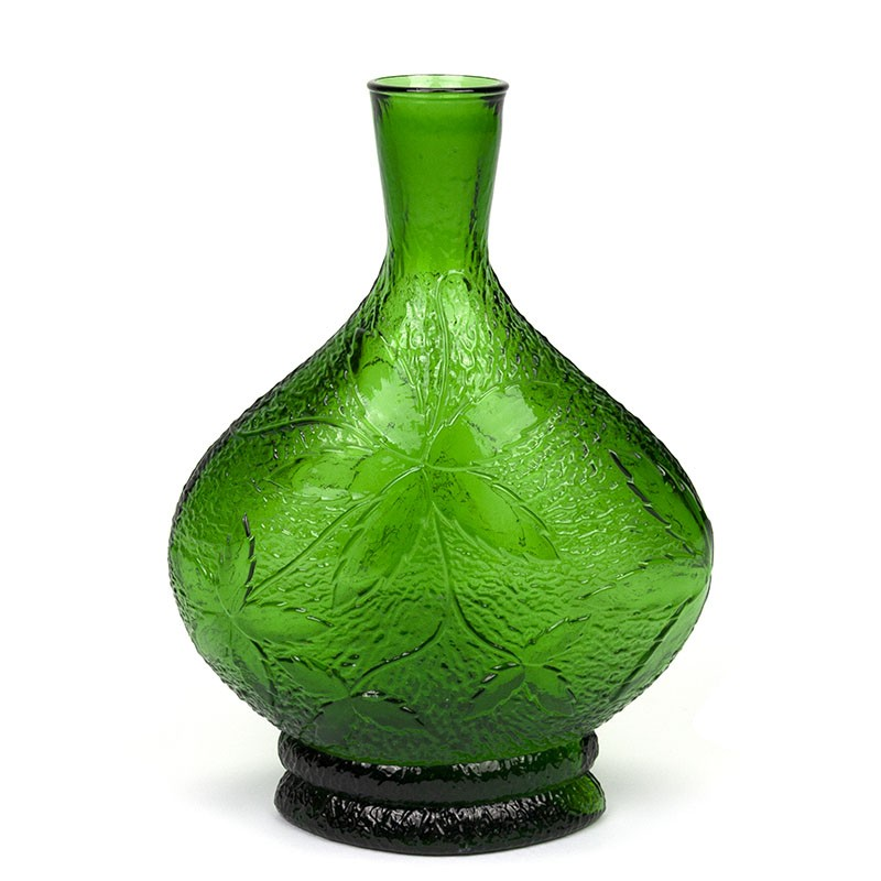 Green glass vintage vase with relief image