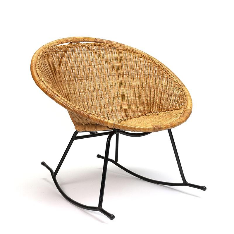 Wicker vintage rocking chair on metal base