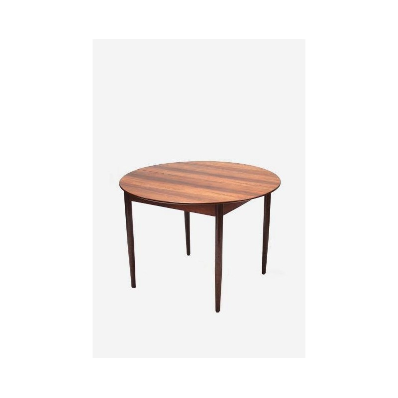 Round dining table in rosewood